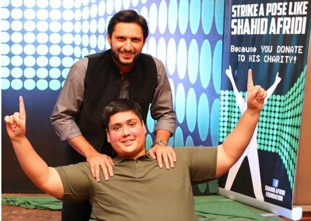 Afridi with a fan during a charity event