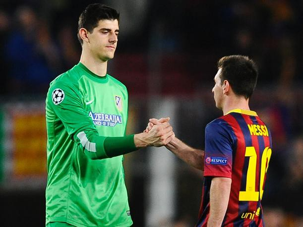 Thibaut Courtois shaking hands with Lionel Messi