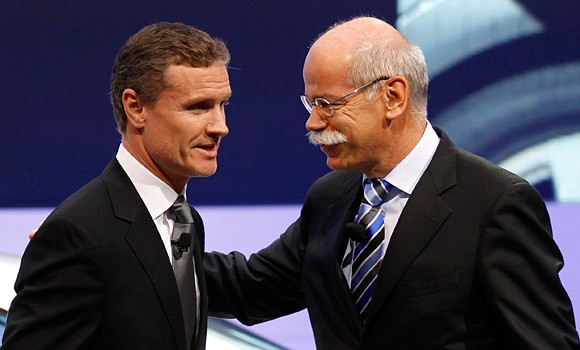 Daimler AG Chief Executive Dieter Zetsche talks to former Formula One champion David