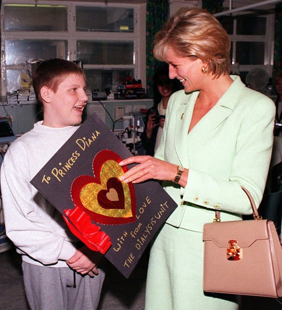 Princess of Wales receiving a hand-made Valentine's card from 16-year old boy