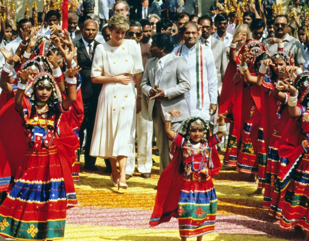 Princess Diana welcomed by a group of dancers during her visit to India