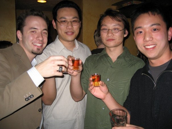 Drew Houston with three asians during a party