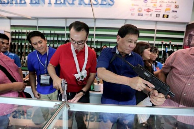 Rody Checking Guns at Arms Show in Mandaluyong City
