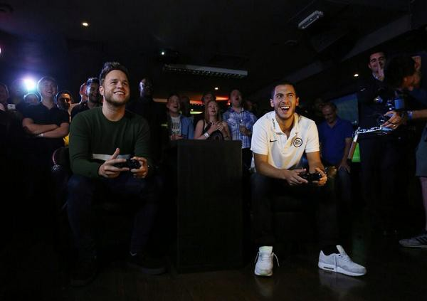 Eden Hazard playing FIFA video game with Olly Murs