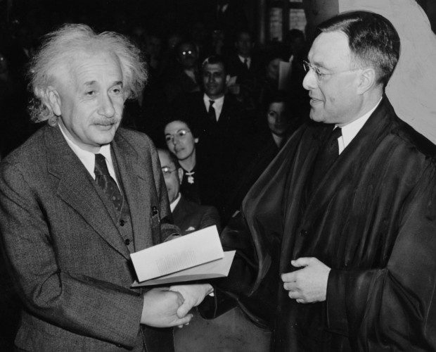 Einstein accepting U.S. citizenship certificate from judge Phillip Forman