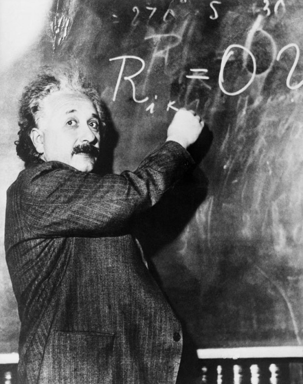 Einstein writing an equation on blackboard at California Institute of Technology