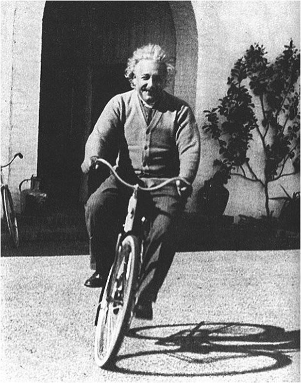 Einstein riding his bicycle