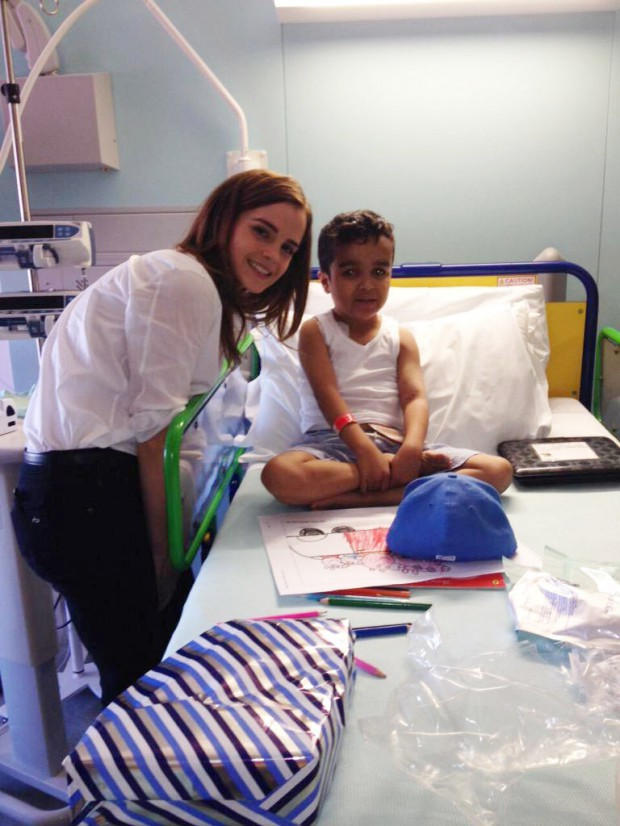 Emma with a child at Great Ormond Street Hospital