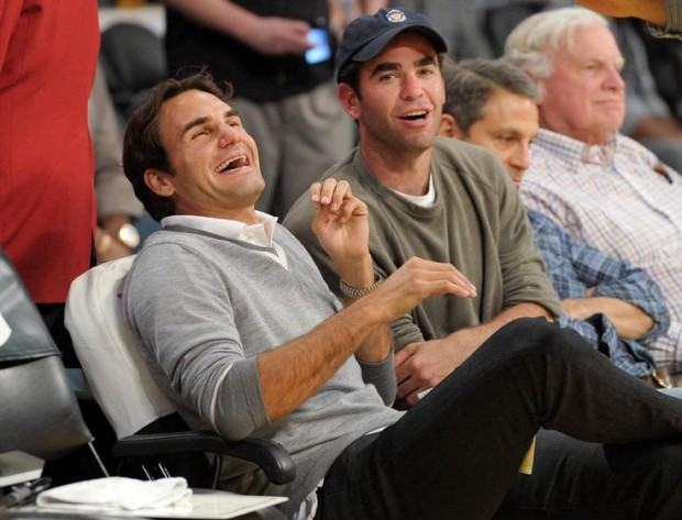 Roger Federer laughs with Pete Sampras