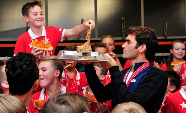 Federer celebrating with kids as he defeats Nadal in a match