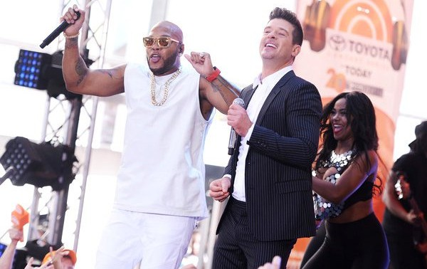 Robin Thicke joins Flo Rida during a concert