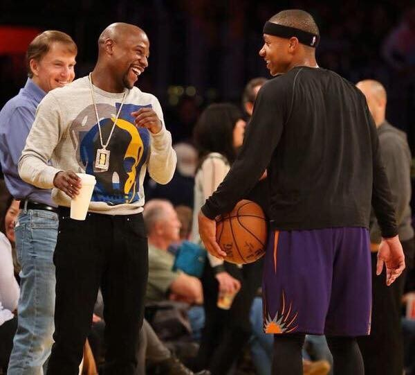 Floyd Mayweather having a funny conversation with Isaiah Thomas
