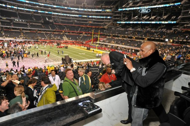 Floyd Mayweather taking photos of fans at Super Bowl XLV in Texas