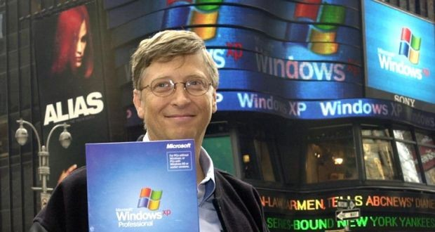 Microsoft's Bill Gates holds up a copy of Windows XP in New York's Times Square