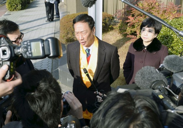 Terry Gou speaking to the media at Sharp headquarters