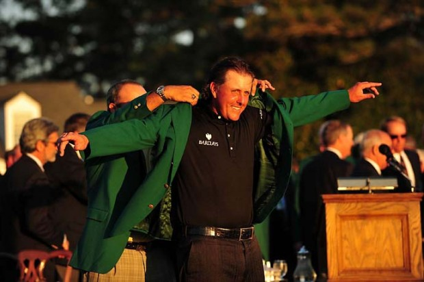 Angel Cabrera puts the green jacket on Phil Mickelson after Mickelson's third Masters win at the 2010 Masters