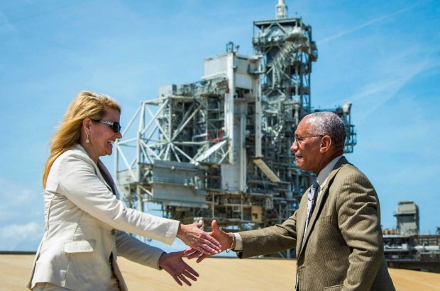 NASA Administrator Charles Bolden shakes hands with SpaceX President and COO Gwynne Shotwell