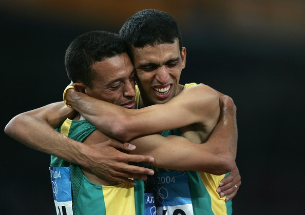 Hicham El Guerrouj of Morocco celebrates with Adil Kaouch