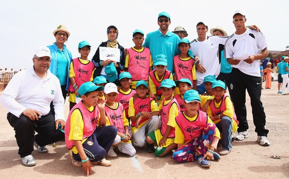 Hicham El Guerrouj and Nawal El Moutawakel pictured with local children during an IAAF Athletics for a Better World Event