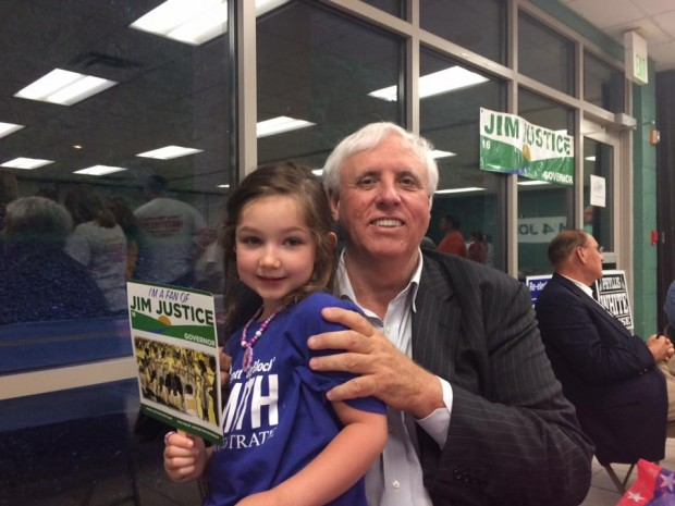 Jim Justice with a kid
