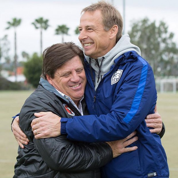 Jurgen Klinsmann and Club Tijuana coach Miguel Herrera greet