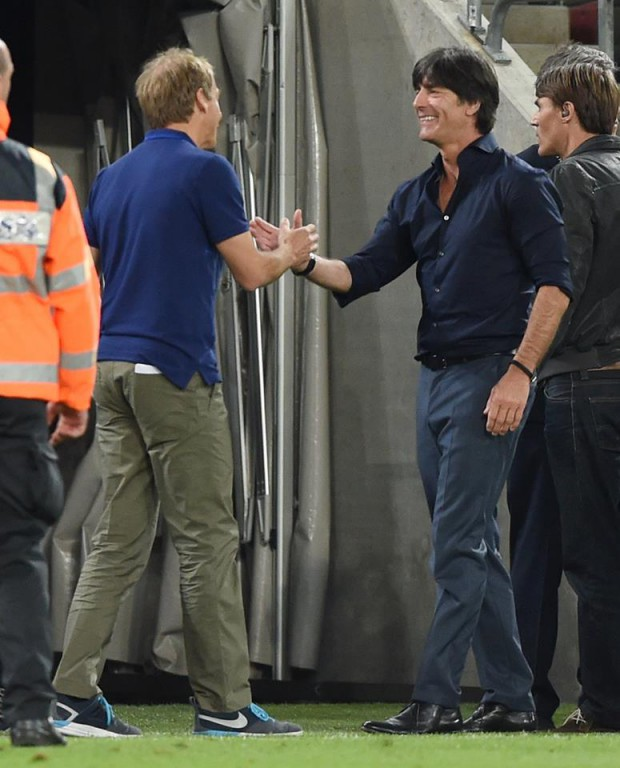 Jurgen shaking hands with Jogi