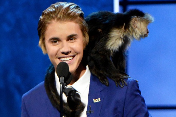 Justin Bieber with His Monkey on Stage