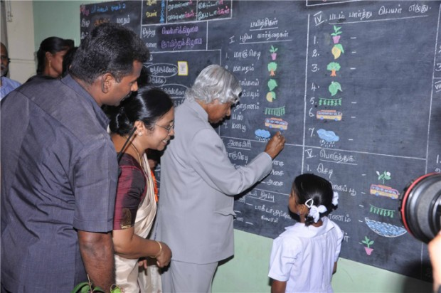 Kalam teaching to a child in a school
