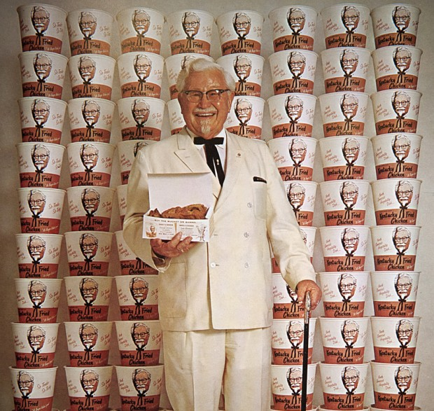 Colonel Sanders with KFC Buckets