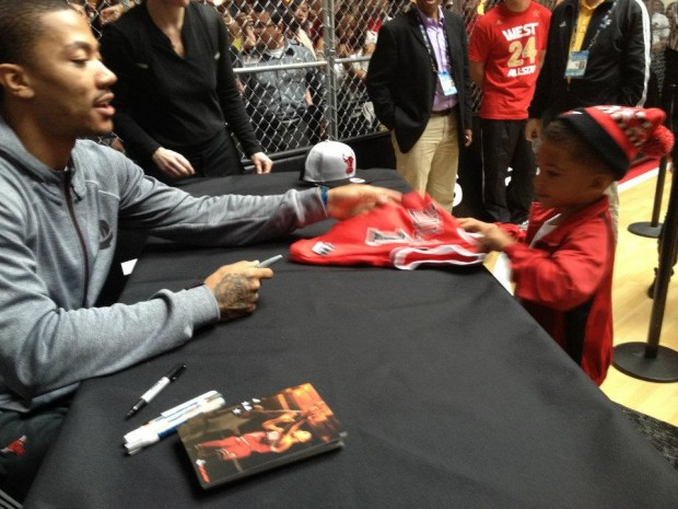 Derrick Rose Signing His Autograph to His Kid Fan