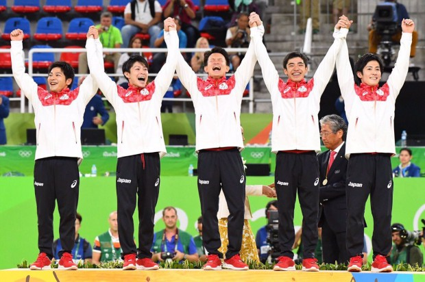 Kohei Uchimura and with fellow teammates at Rio Olympics 2016