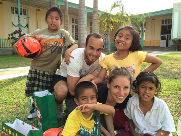Landon with kids in Peru
