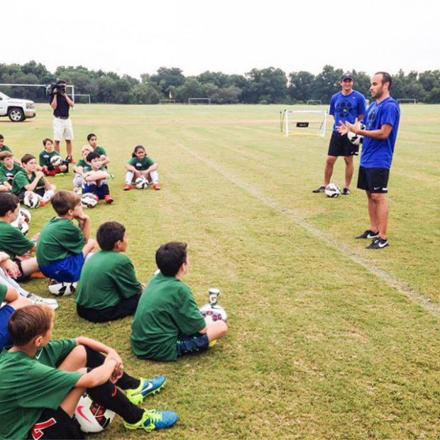 Landon Donovan in a coaching session for kids