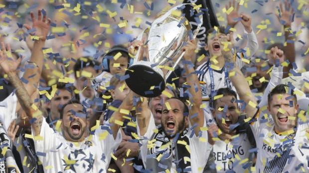 Landon lifts MLS trophy along with LA Galaxy teammates