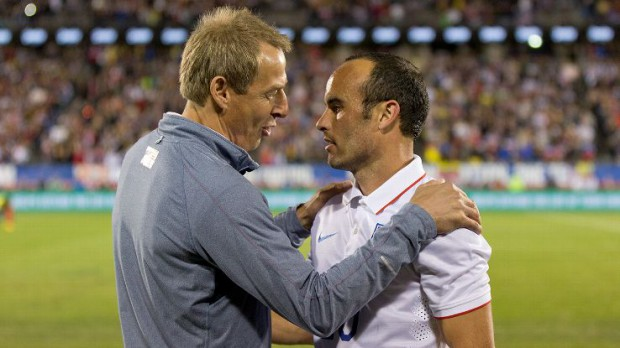 Bruce Arena speaking with Landon Donovan