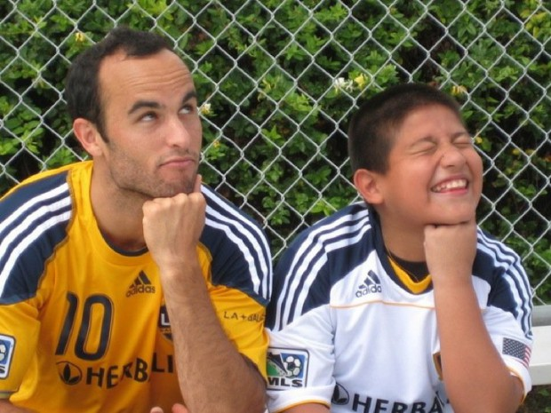 Landon Donovan with a boy from Make-A-Wish Organization
