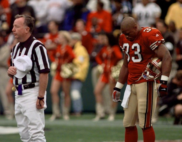Lawrence and Referee bow their heads for a moment of silence for the death of Walter Payton