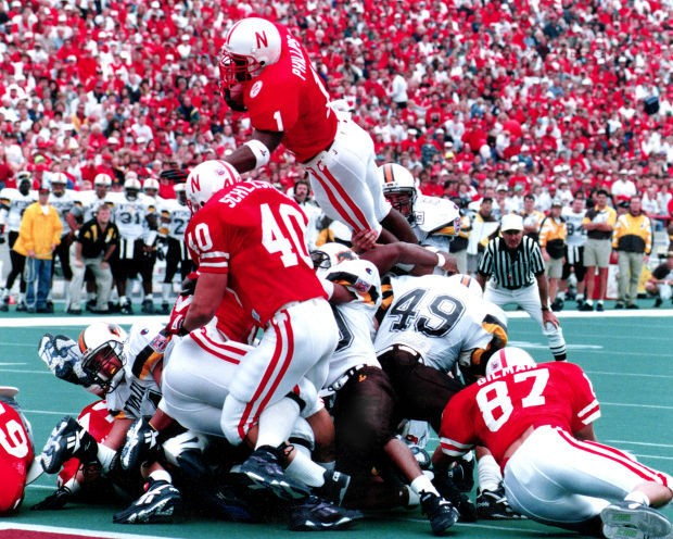 Lawrence Phillips jump over the top of the pile