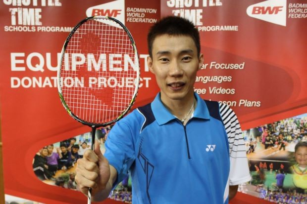 Lee Chong Wei with the racquet he donated to Badminton World Federation's Equipment Donation Project