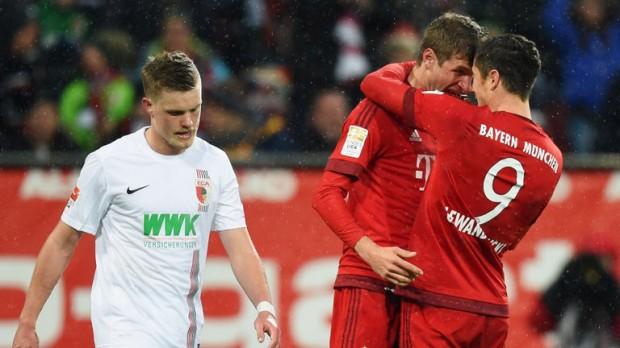 Robert Lewandowski celebrates after scoring goal with Thomas Muller