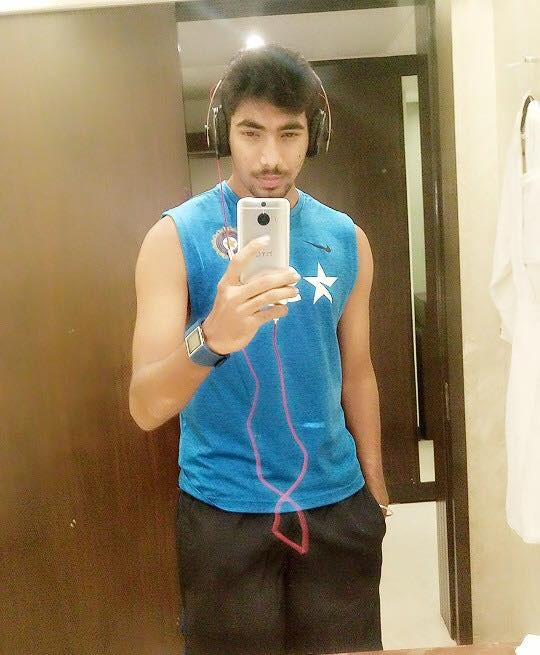 Jasprit Listening to Music in His Phone
