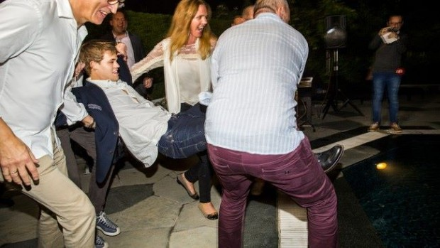 Carlsen thrown into swimming pool by his friends after winning world championship