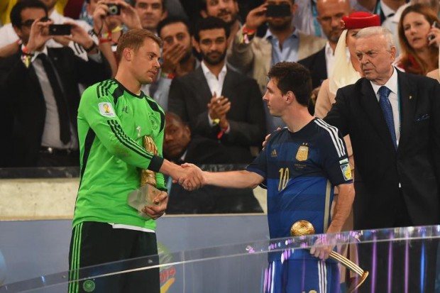 Lionel Messi shaking hands with Manuel Neuer during World Cup Presentation
