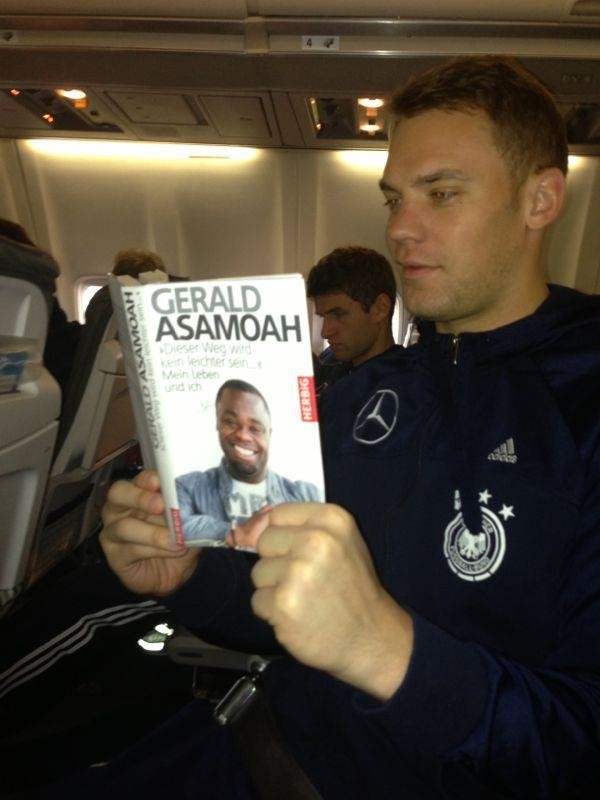 Manuel Neuer reading Gerald Asamoah's Book