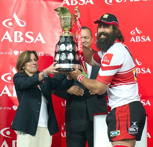 Golden Lions Captain Joshua Strauss received the ABSA Currie Cup trophy from Maria Ramos CEO of ABSA