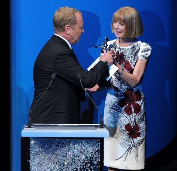 Michael accepts his CFDA award from Anna Wintour