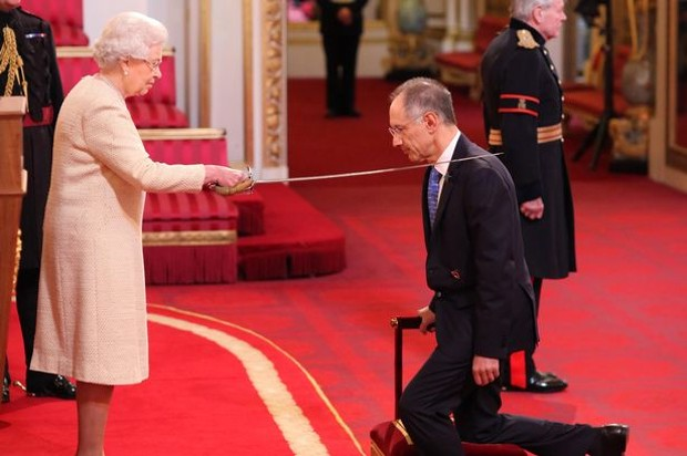 Michael Moritz is knighted by Queen Elizabeth II at Buckingham Palace