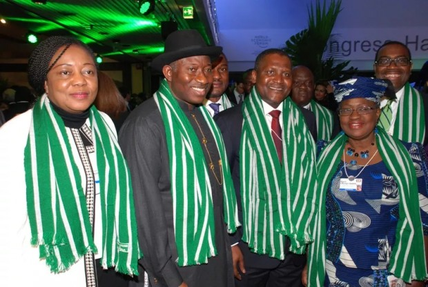 Fidelia Njeze Akuabata, President Goodluck Jonathan, Chairman Aliko Dngote Group Alh. Aliko Dangote, and Finance Minister Dr, Ngozi Okonjo Iweala at the World Economic Forum in Davos