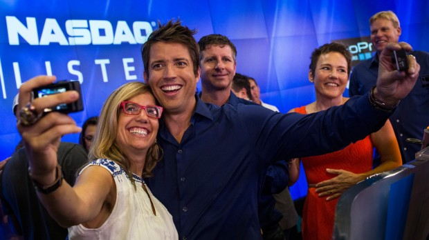 Nick Woodman takes a selfie with coworkers during the company's initial public offering (IPO) at the Nasdaq Stock Exchange