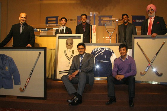 Paes along with other Indian sports men along with their sports items for an auction to a charity foundation